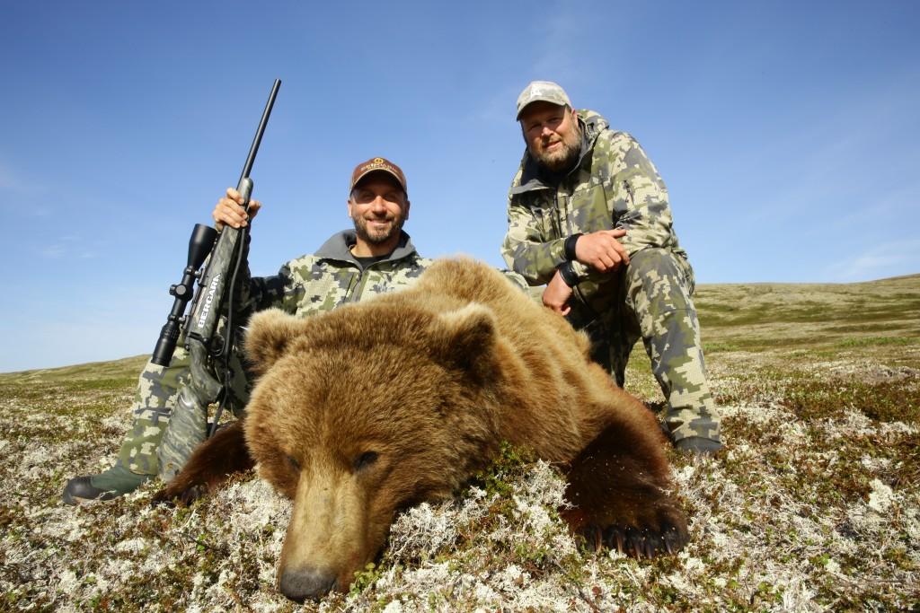 Dan Hanus and Steve West pose with a beautiful brown bear Dan killed in Alaska earlier this year.